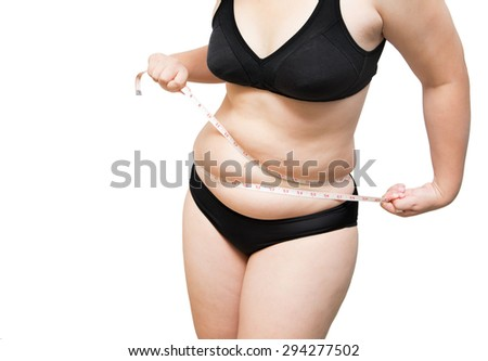 Woman show and squeeze tighten body fat by measure tape or line tape wearing black underwear bra on white isolated - stock photo