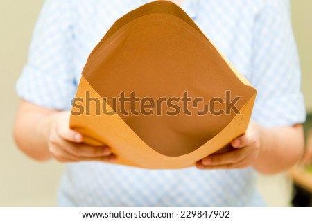 woman show blank envelope - stock photo