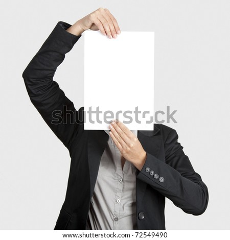 Woman showing a blank paper sheet in front of her head - stock photo