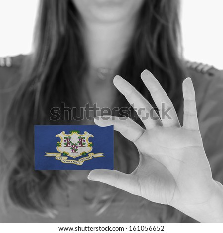 Woman showing a business card, black and white, Connecticut - stock photo