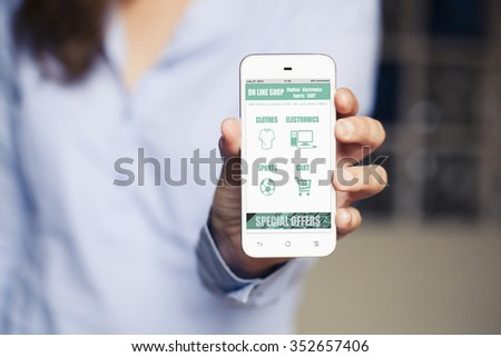 Woman showing a mobile phone with on line shop website app on the screen. - stock photo