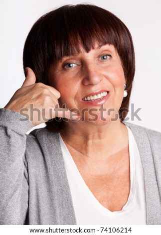 Woman, showing a sign of call - stock photo
