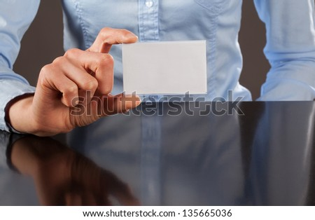 Woman showing blank business card - closeup shot - stock photo