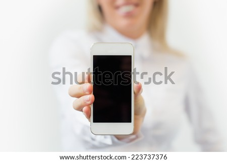 Woman showing blank mobile phone's screen vertically - stock photo