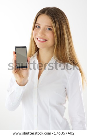 Woman showing empty display of her touch mobile phone - stock photo