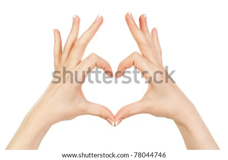 woman showing hands heart on a white background - stock photo