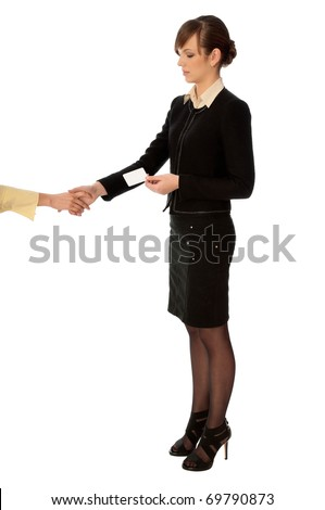 woman showing her badge at the entrance of meeting room and gives hand for a handshake - stock photo