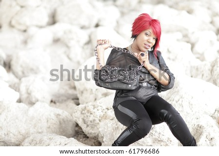 Woman showing her handbag - stock photo