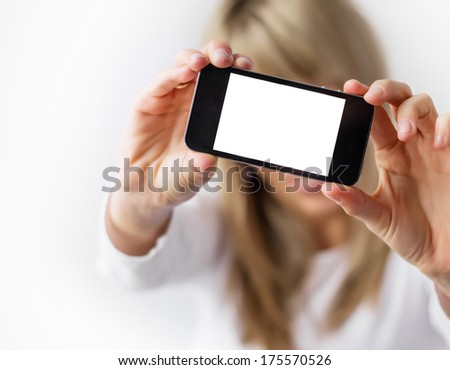 Woman showing mobile phone with empty display. - stock photo