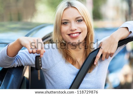 Woman Showing off New Car Keys - stock photo