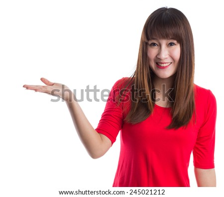 Woman showing, presenting something with open hand palm to copy space over white background - stock photo