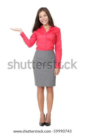 Woman showing product with open hand palm. Isolated on white background. Beautiful young mixed Asian Chinese / white Caucasian woman standing in full length.