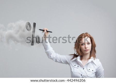 Woman showing symbol of percent. Bank Deposit or Sale concept. - stock photo
