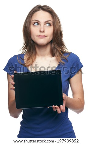 Woman showing tablet screen looking up at copy space, isolated on white background