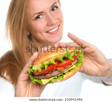 Woman showing tasty unhealthy burger sandwich in hands hungry getting ready to eat isolated on a white background Fast food concept - stock photo