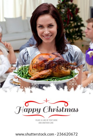 Woman showing to the camera Christmas turkey against border - stock photo