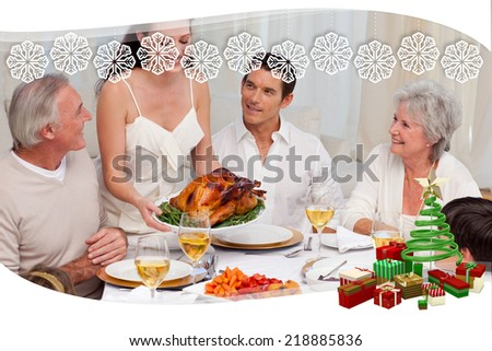 Woman showing turkey to her family for Christmas dinner against snowflake frame