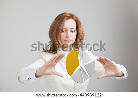 Woman shows a pie chart, circle diagram. Business analytics concept. - stock photo