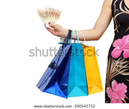 woman shows money savings with al lot of shopping bags - stock photo