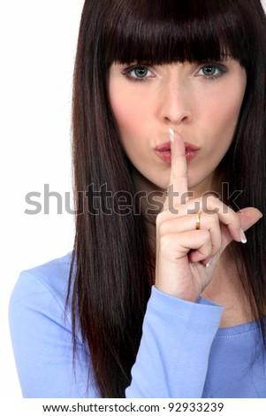 Woman shushing - stock photo
