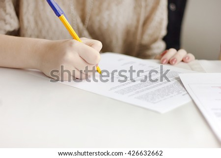 Woman signed documents - stock photo