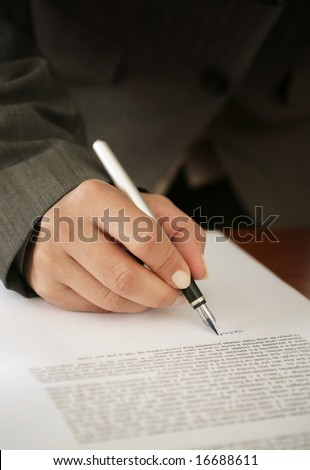 Woman signing a contract - stock photo