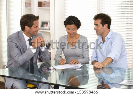 Woman signs a document - stock photo