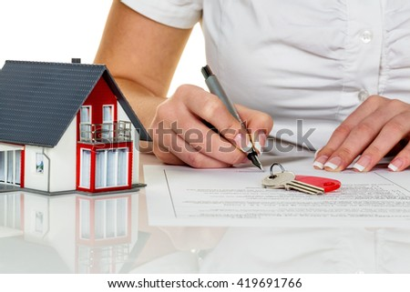 woman signs agreement for house - stock photo