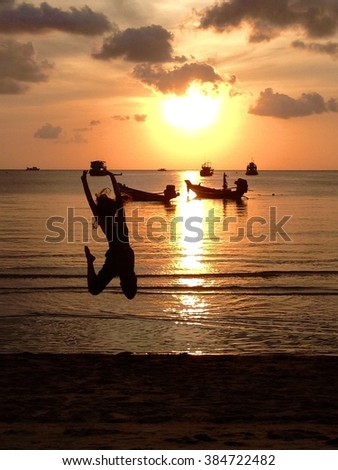 Woman silhouette, Sunset over Turtle island In Thailand
