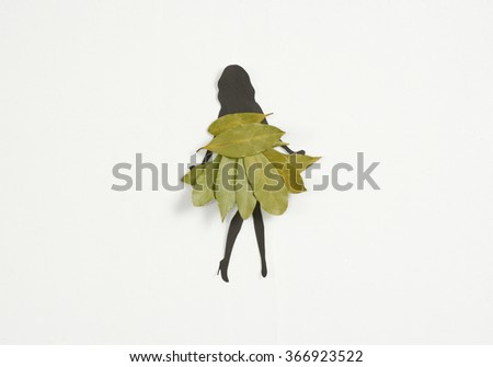 woman silhouette wearing a dress of laurel leaves - stock photo