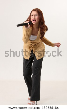 Woman singing, holding wireless microphone