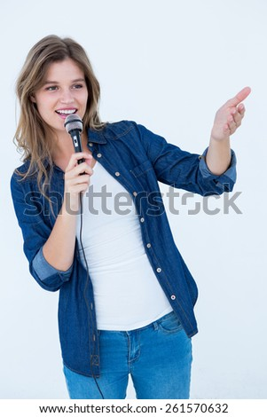 Woman singing with a microphone on white background - stock photo