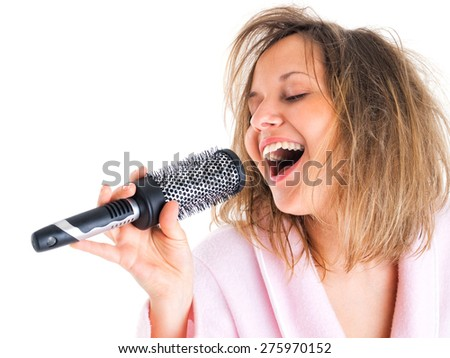 Woman singing with hairbrush isolated on white background