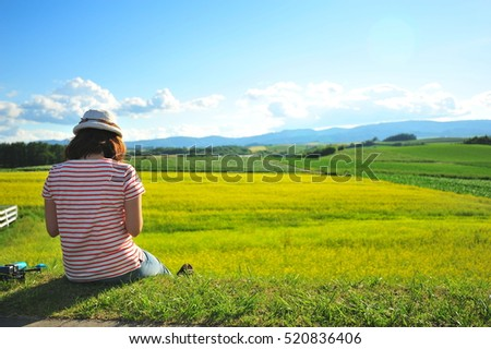 Woman Sit and Realx at Flower Fields in Summer