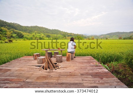 Woman Sit On The Terrace  Among Rice Field - stock photo