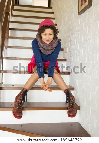 woman sits on a ladder - stock photo