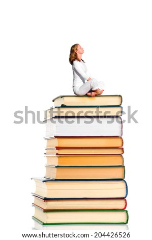 Woman sits on the stack of books