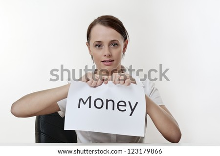 woman sitting at a desk getting rid of all her money problems