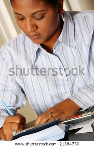Woman sitting at a table paying bills