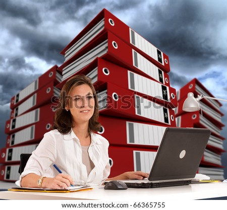 Woman sitting at her desk with piles of ring binders at the background and a cloudy sky - stock photo