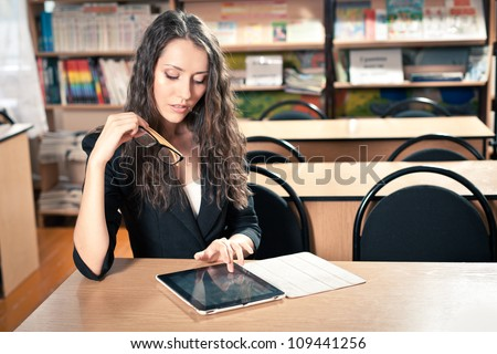 woman sitting at reading hall and touching tablet pc