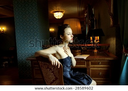 woman sitting in a luxury interior - stock photo