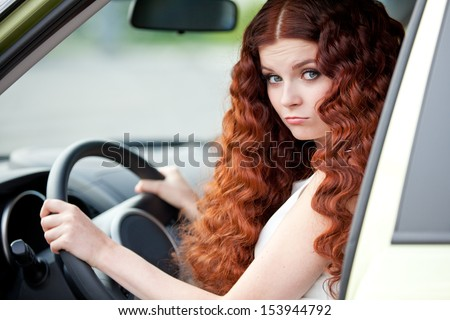 Woman sitting in car - stock photo