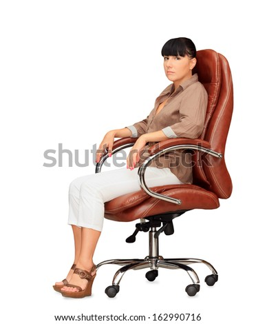 Woman sitting in office chair - stock photo