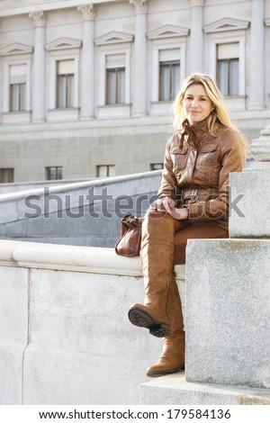 woman sitting in Vienna, Austria - stock photo