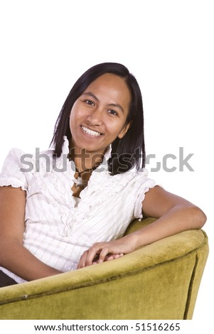 Woman sitting on a chair with white background