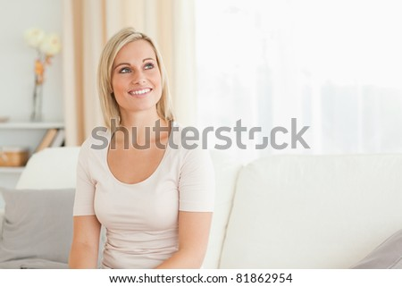 Woman sitting on a sofa looking away from the camera