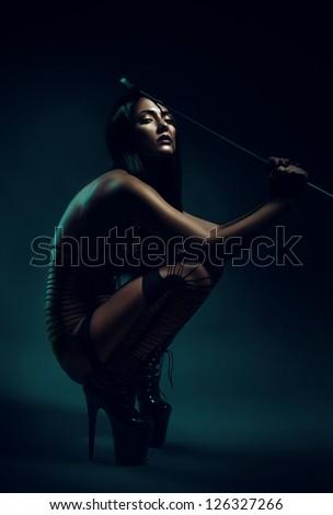 woman sitting on high heels - stock photo