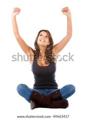 Woman sitting with arms up isolated over a white background - stock photo