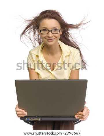Woman sitting with laptop on her knees. Her blouse and hair are wind-blown. Isolated on white in studio. - stock photo
